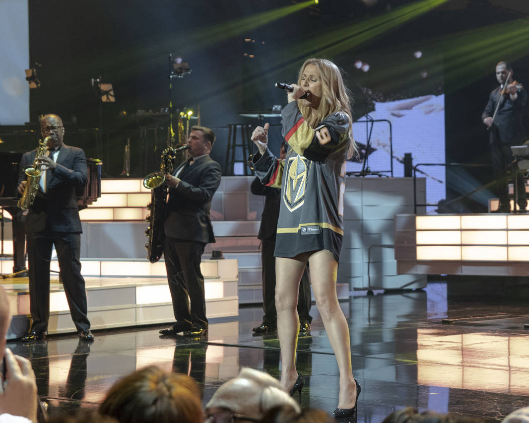 Celine Dion, shown with sax players Phil Wifgall and Eric Tewalt, sports a Marc-Andre Fleury Vegas Golden Knights jersey during her return to the Colosseum at Caesars Palace after minor ear surger ...