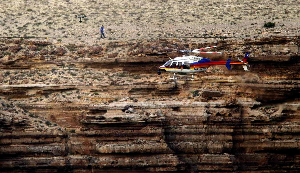 Daredevil Nik Wallenda crosses a tightrope 1,500 feet above the Little Colorado River Gorge, Ariz., on the Navajo Nation outside the boundaries of Grand Canyon National Park, June 23, 2013. (Rick ...