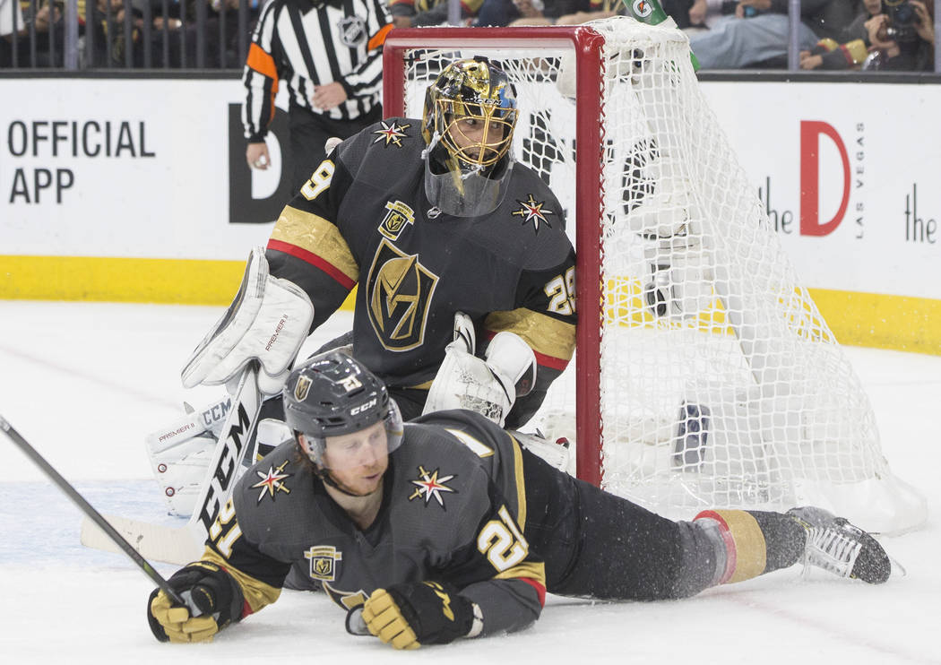 Golden Knights goaltender Marc-Andre Fleury (29) makes a save with the help of center Cody Eakin (21) in the second period during game four of Las Vegas' NHL Western Conference Finals matchup with ...