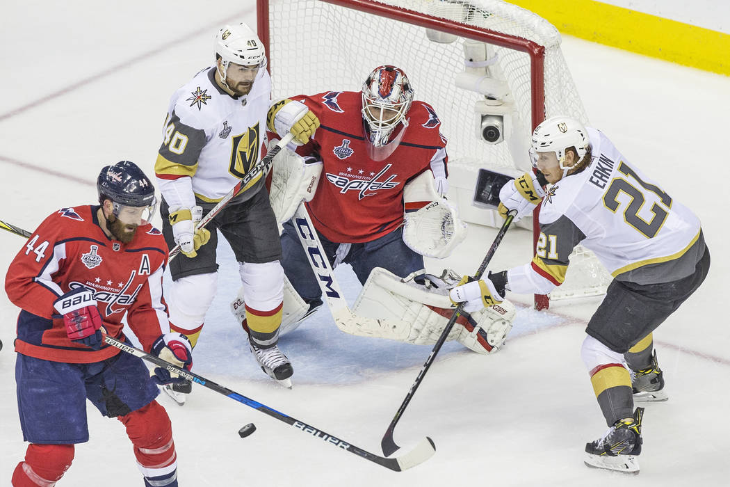 Capitals goaltender Braden Holtby (70) makes a second-period save against Golden Knights center Cody Eakin (21) and center Ryan Carpenter (40) during Game 4 of the NHL Stanley Cup Final on Monday, ...