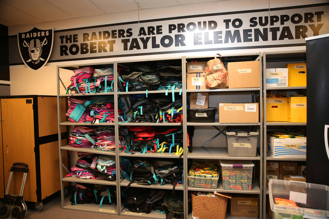 School supplies donated by the Raiders as part of the Communities In Schools of Southern Nevada program which promotes student success for all children, are displayed at Robert Taylor Elementary S ...