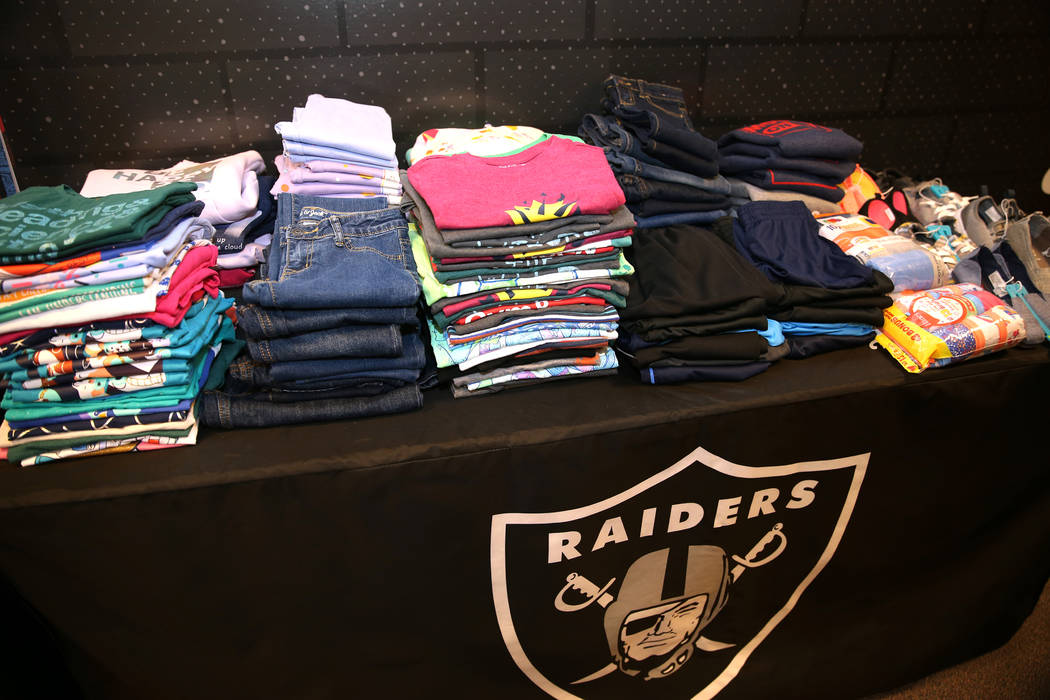 Clothes donated by the Raiders as part of the Communities In Schools of Southern Nevada program which promotes student success for all children, are displayed at Robert Taylor Elementary School in ...