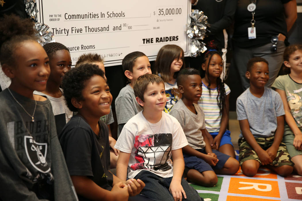 Students smile for a photo after the Raiders presented a $35,000 donation to Communities In Schools of Southern Nevada program which promotes student success for all children, at Robert Taylor Ele ...