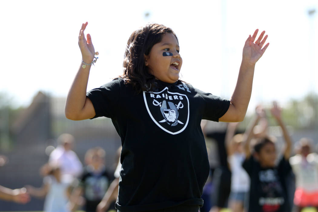 Third grade student Bella Rivera, 8, participates in a Raiders youth football camp at Robert Taylor Elementary School in Henderson, Tuesday, Sept. 25, 2018. The Raiders adopted a Communities In Sc ...