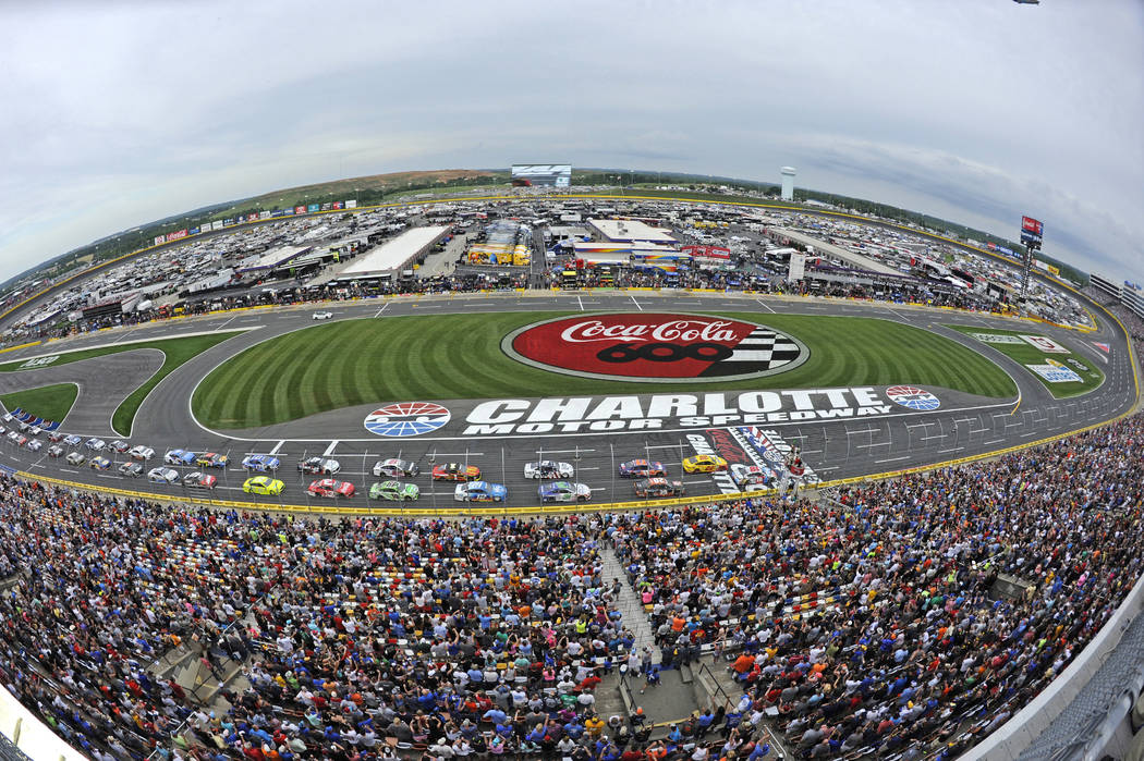 FIILE - In this May 27, 2018 file photo taken with a fisheye lens, the field takes the green flag to start the NASCAR Cup Series auto race at Charlotte Motor Speedway in Charlotte, N.C. Charlotte ...