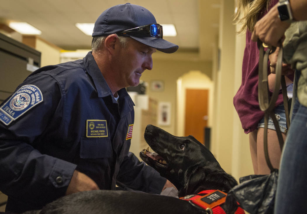 Mike Porter from Henderson Fire Department greets his dog, Allie, as Nevada Task Force 1 returns from areas affected by Hurricane Florence in Las Vegas, Monday, Sept. 24, 2018. Caroline Brehman/La ...