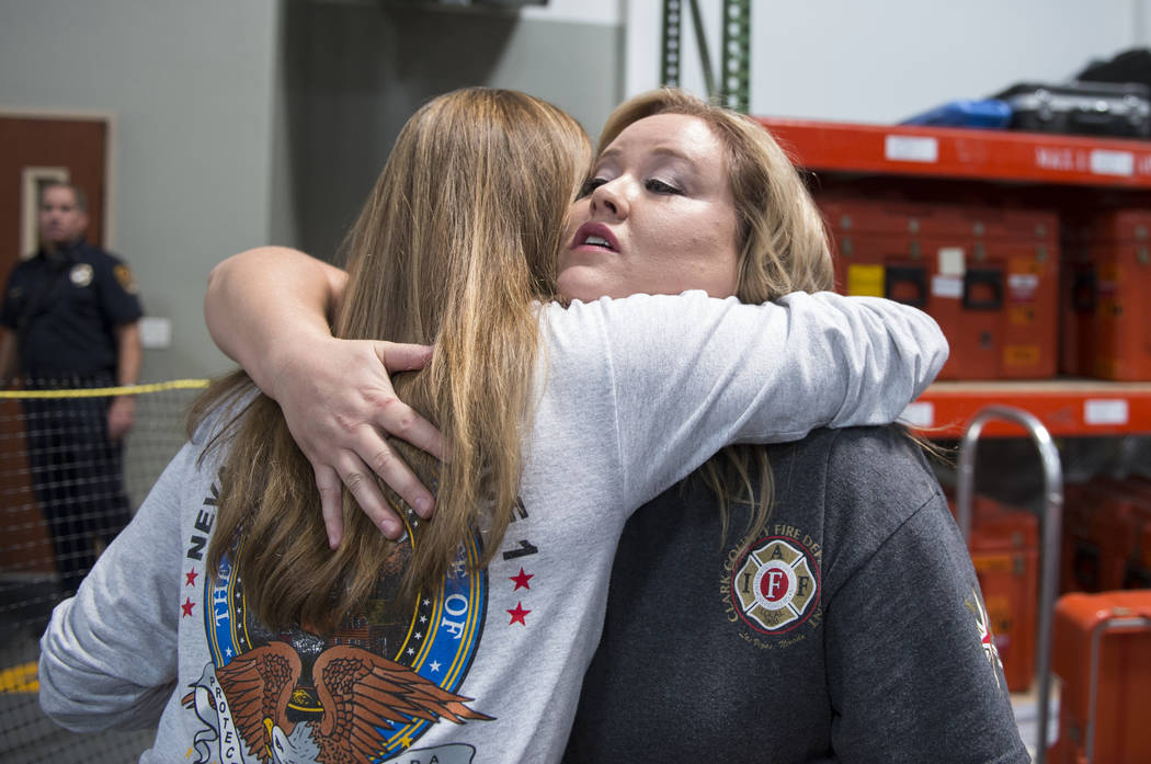 Rebecca Ritz, wife of Jason Ritz from Clark County Fire Department, hugs Dina Dalessio, a Las Vegas fire captain and task force leader for the Hurricane Florence mission, as Nevada Task Force 1 re ...