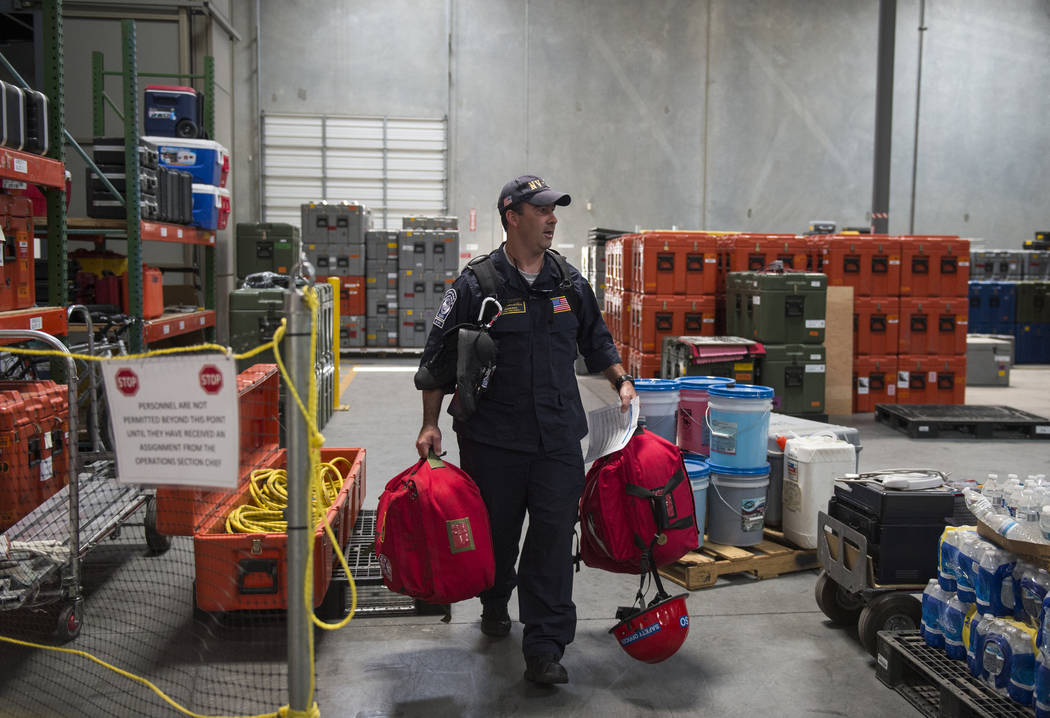 Jason Ritz from Clark County Fire Department unloads gear packed for the Hurricane Florence mission as Nevada Task Force 1 returns from areas affected by Hurricane Florence in Las Vegas, Monday, S ...