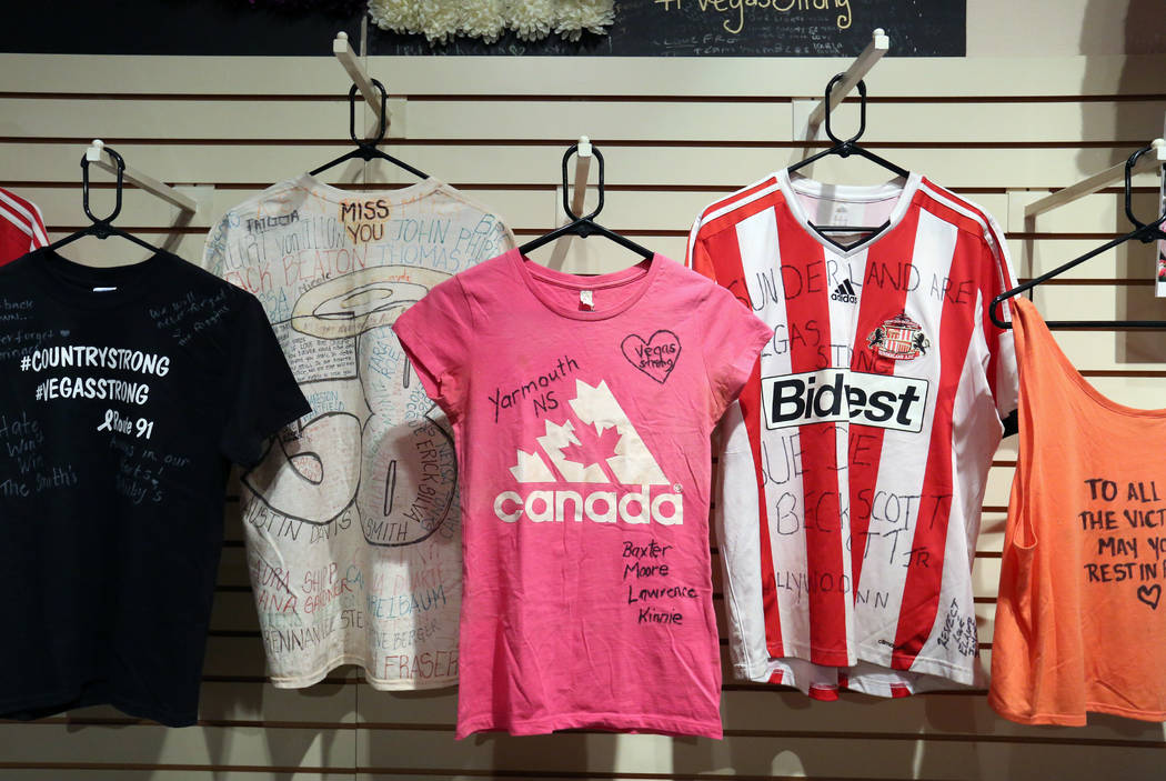 Artifacts and T-shirts used to honor the victims killed in the Route 91 Harvest festival shooting are displayed at the Clark County Museum on Monday, Sept. 24, 2018, in Henderson. (Bizuayehu Tesfa ...