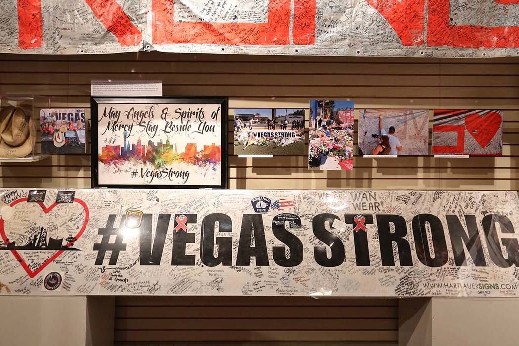 Artifacts used to honor the victims killed in the Route 91 Harvest festival shooting are displayed at the Clark County Museum during the opening of an exhibit 'How We Mourned' on Sept. 24, ...