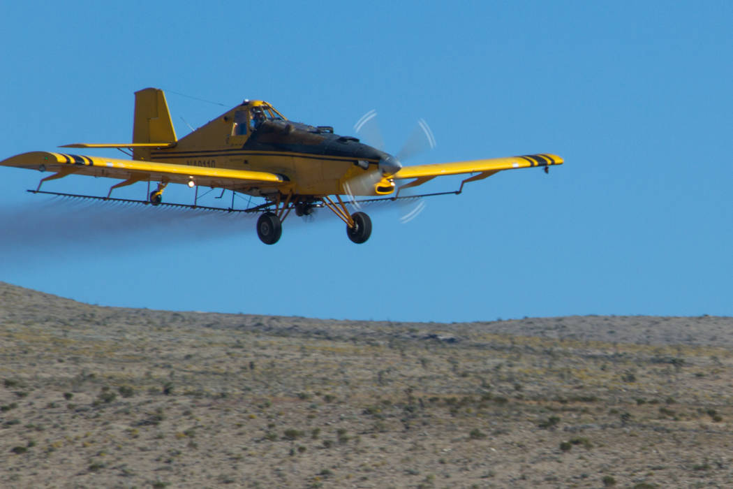 An airplane sprays herbicide on public land southwest of the Las Vegas Valley on Oct. 3, 2017, as part of an effort to halt the spread of invasive grasses in an area burned by the Goodsprings Fire ...