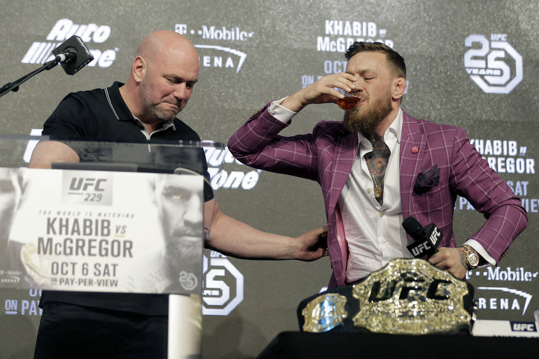 Conor McGregor, right, and UFC president Dana White have a drink during a news conference in New York, Thursday, Sept. 20, 2018. McGregor is returning to UFC after a two-year absence. He fights un ...