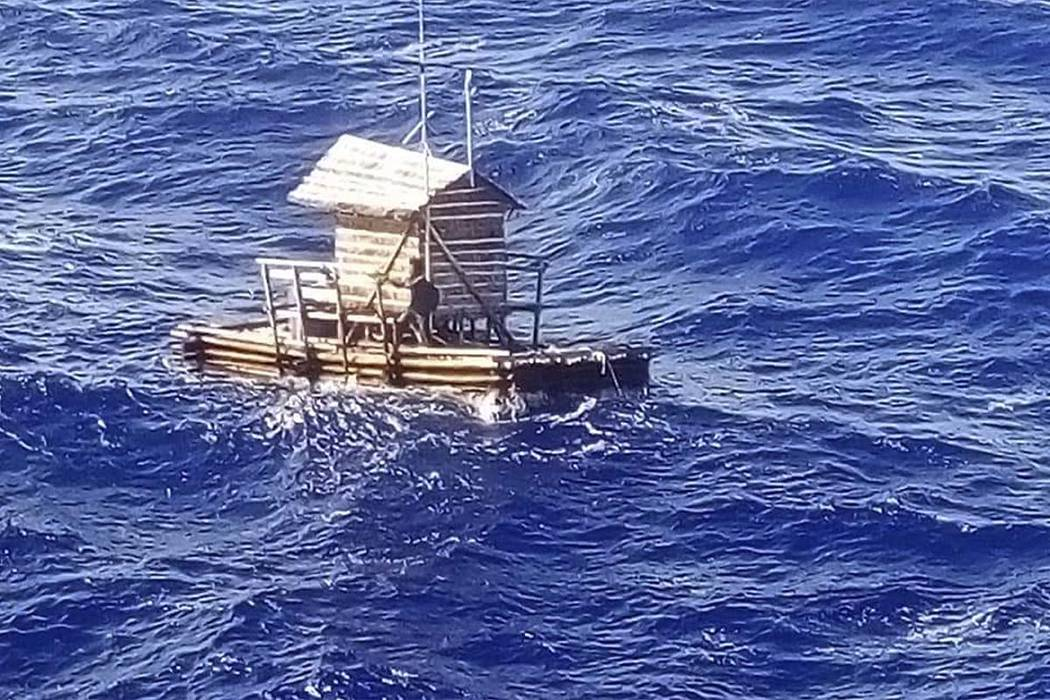 In this undated photo released by Indonesian Consulate General in Osaka, 18-year-old Aldi Novel Adilang is seen on a wooden fish trap floating in the waters near the island of Guam. (Indonesian C ...