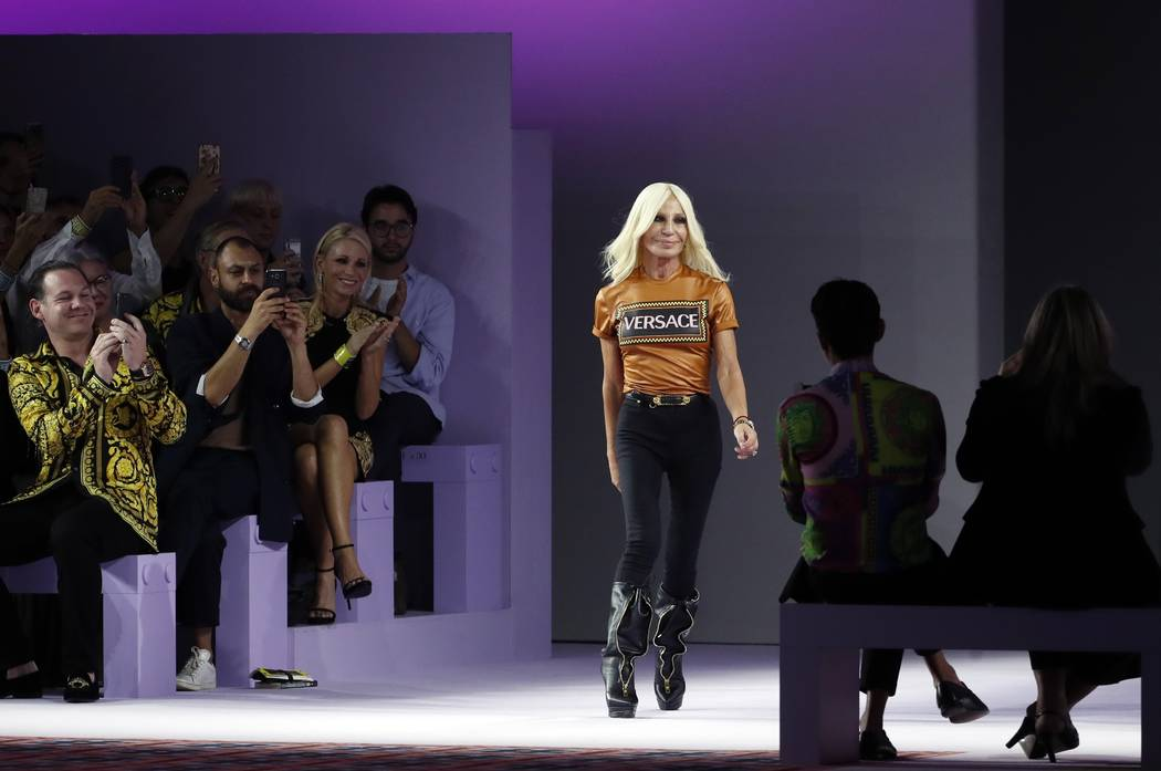 227486fcc5ca Donatella Versace comes on the catwalk at the end of Versace s women s 2019  Spring-Summer