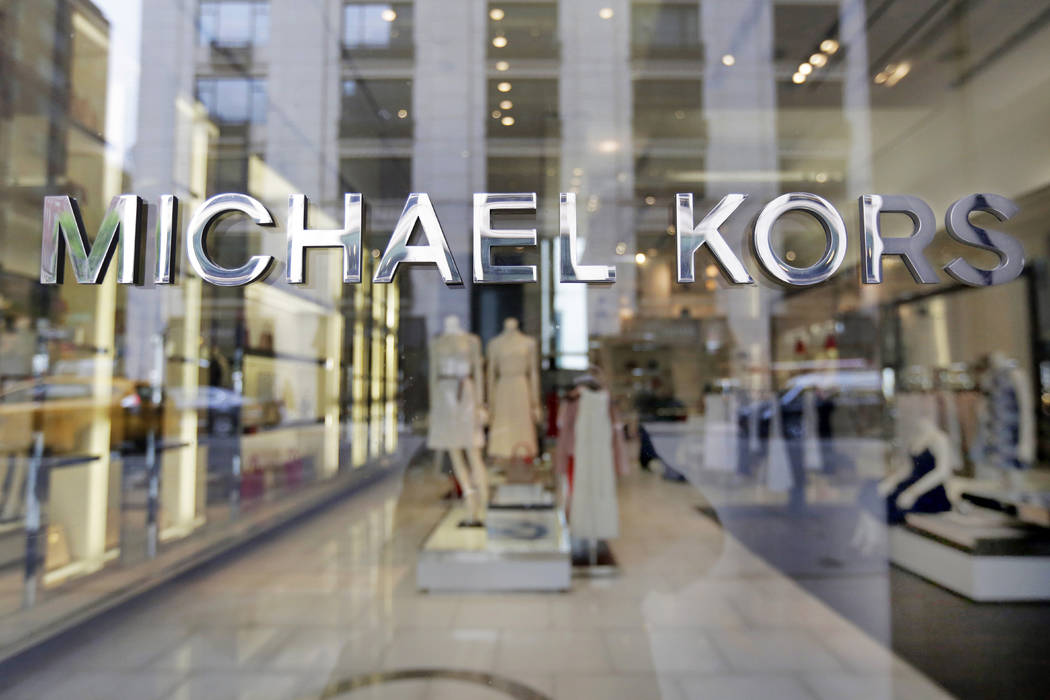 The Michael Kors name adorns his store on Madison Avenue, in New York on May 31, 2017. (AP Photo/Richard Drew, File)