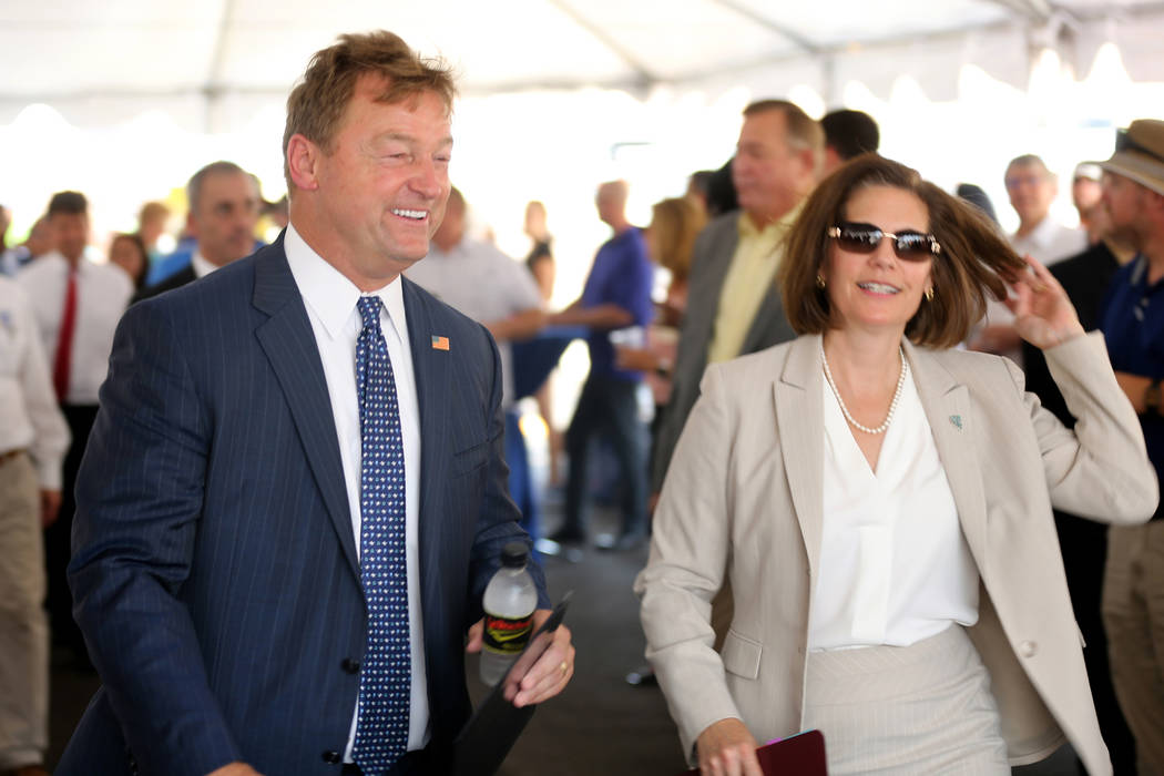 U.S. Sens. Dean Heller, R-Nevada, and Catherine Cortez Masto, D-Nevada, arrive for the opening ceremony for Interstate 11 near Boulder City, Thursday, Aug. 9, 2018. (K.M. Cannon/Las Vegas Review-J ...