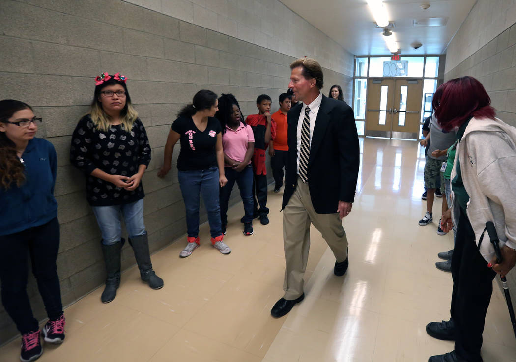 Dr. James Kuzma, Rancho High School principal, walks past students on Monday, Sept. 24, 2018, in Las Vegas. (Bizuayehu Tesfaye/Las Vegas Review-Journal) @bizutesfaye
