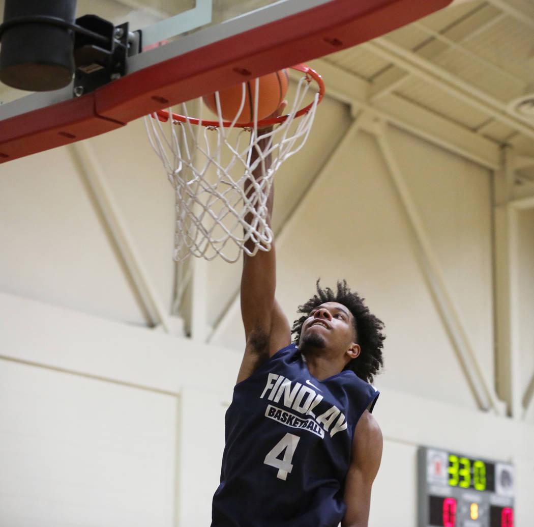 Findlay Prep's PJ Fuller, committed to TCU, dunks on the net at the beginning of practice held at Henderson International School in Henderson, Tuesday, Sept. 25, 2018. Caroline Brehman/Las Vegas R ...