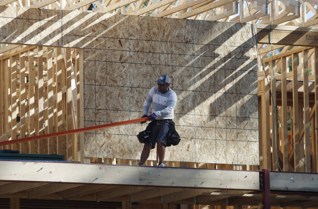 A worker toils on a new home under construction in Denver, Thursday, Aug. 30, 2018. A slowdown in U.S. home sales is weighing on homebuilder stocks. Most of the builders are down more than 15 perc ...