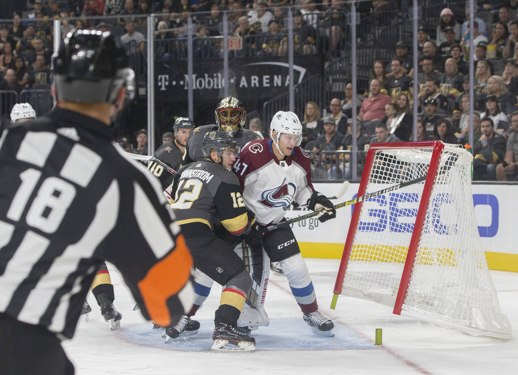 Colorado Avalanche center Dominic Toninato (47) knocks the net loose with Golden Knights defenseman Erik Brannstrom (12) on his heels in the first period during their NHL preseason matchup on Mond ...