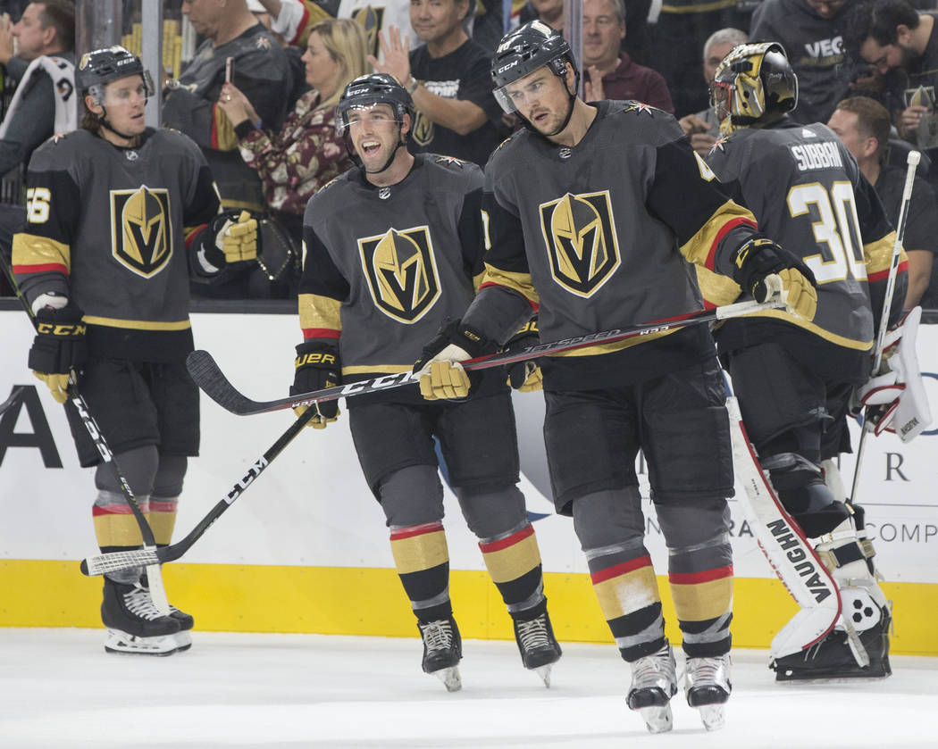 The Golden Knights celebrate after defenseman Jake Bischoff (45, third from left) scored a third period goal during Vegas' NHL preseason matchup with the Colorado Avalanche on Monday, Sept. 24, 20 ...