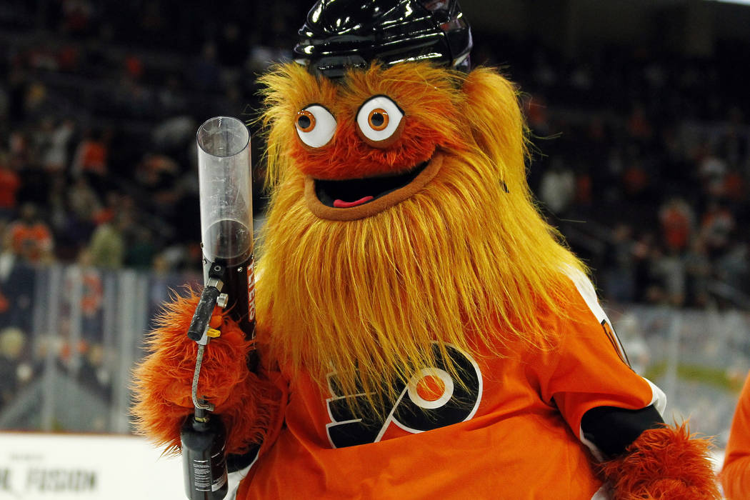 The Philadelphia Flyers new mascot, Gritty, takes to the ice during the first intermission of the Flyers' preseason NHL hockey game against the Boston Bruins,in Philadelphia on Sept. 24, 2018. The ...