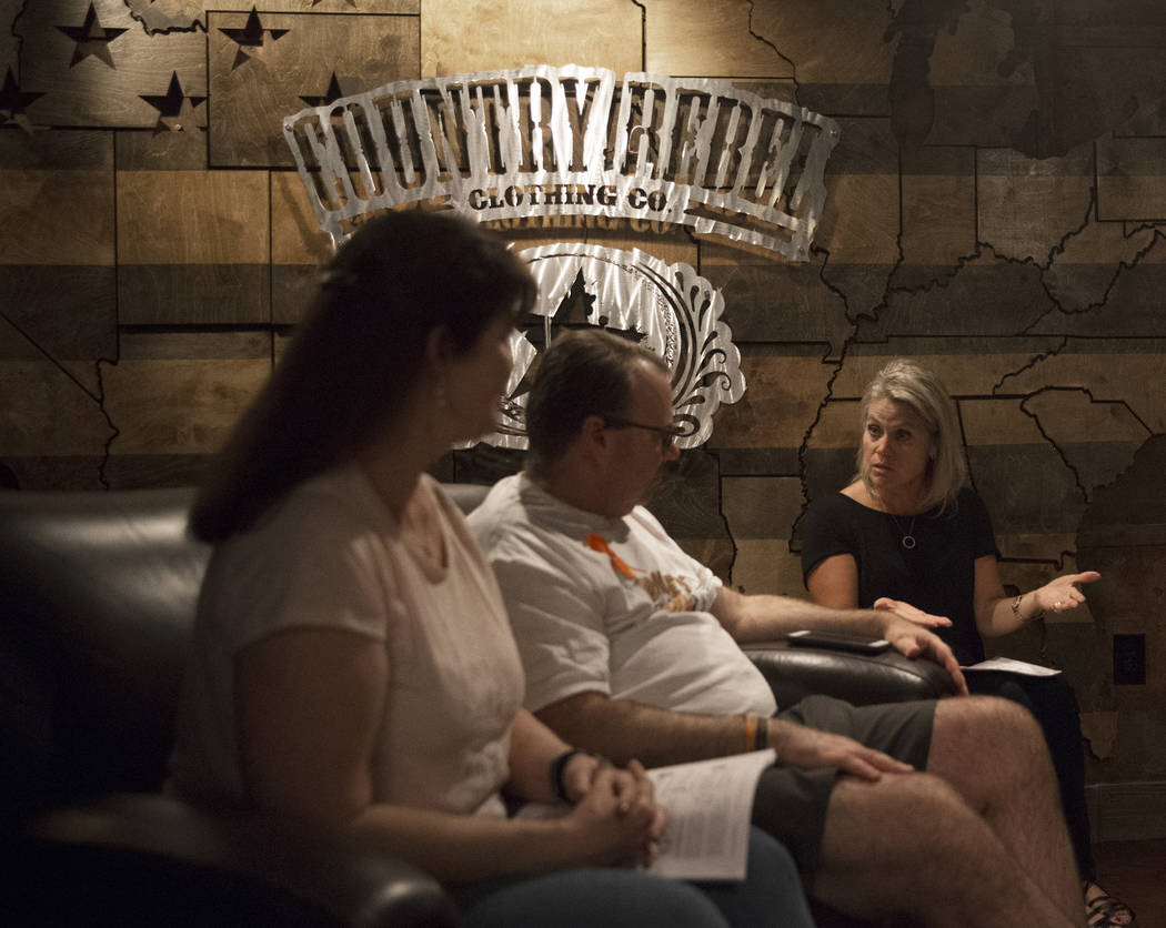 Deb Dailey, left, president of the EMS Training Center of Southern Nevada, Chris Philippsen and Kristine Schalk discuss their anxieties leading up to the anniversary of October 1 during a local Ro ...