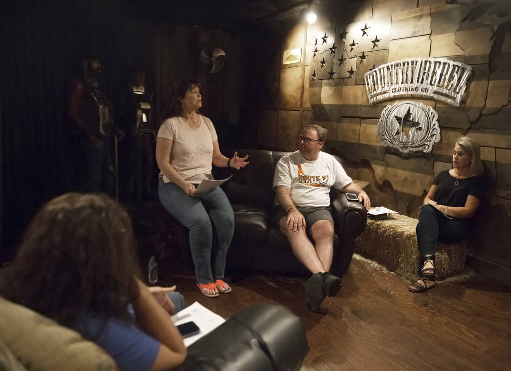 Deb Dailey, second from left, president of the EMS Training Center of Southern Nevada, Chris Philippsen and Kristine Schalk discuss the steps of healing at a local Route 91 survivors support group ...