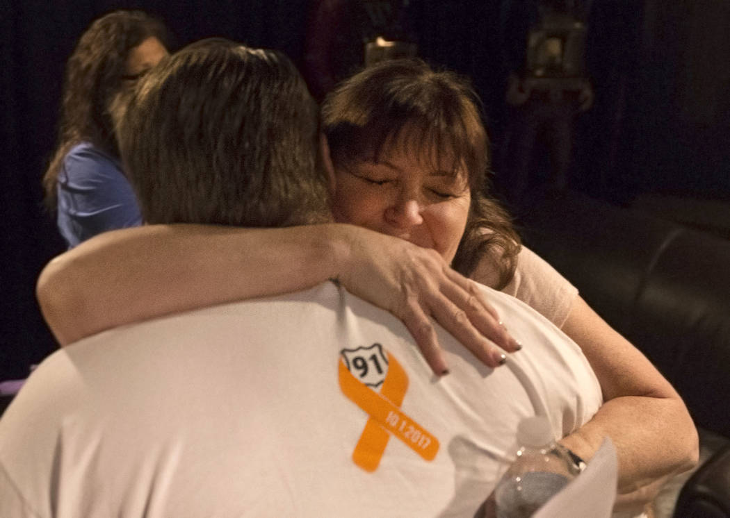Deb Dailey, president of the EMS Training Center of Southern Nevada, hugs Chris Philippsen at the conclusion of a local Route 91 survivors support group on Wednesday, Sept. 26, 2018, at Stoney's R ...