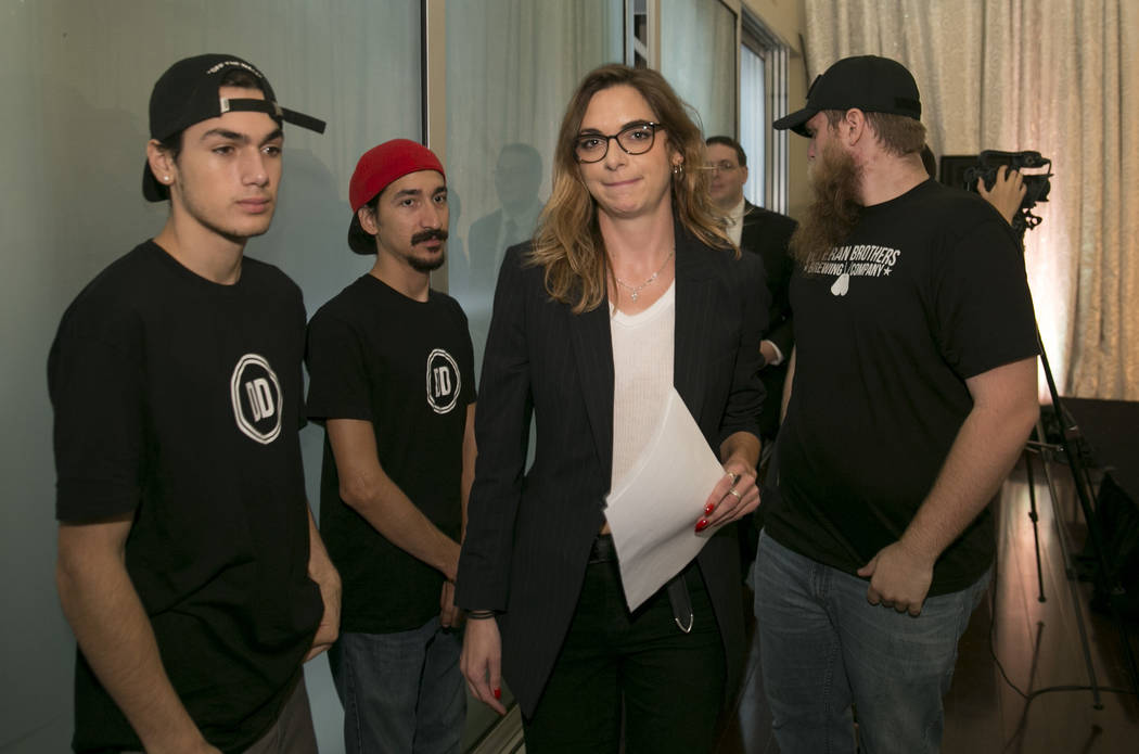 Paloma Heindorff walks past Defense Distributed employees after she was introduced as the new director of Defense Distributed at a news conference at the Sterling Events Center in Austin, Texas, o ...