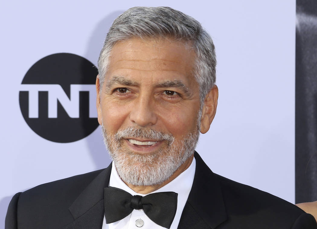 In this June 7, 2018, file photo, George Clooney arrives at the 46th AFI Life Achievement Award Honoring himself at the Dolby Theatre in Los Angeles. Clooney tops the 2018 Forbes' list of highest- ...