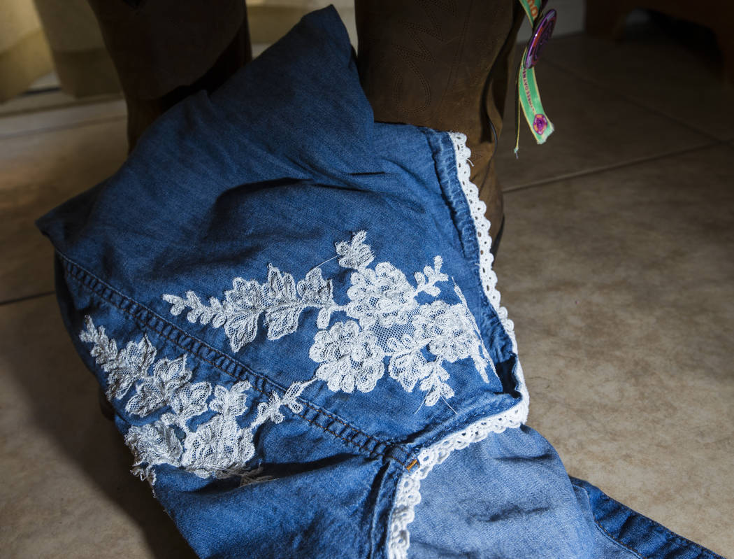 The denim shirt that were worn by Teche Bergeron the night of Oct. 1 as she escaped the festival grounds in Las Vegas on Friday, Aug. 17, 2018. Bergeron was wounded by shrapnel during the shooting ...