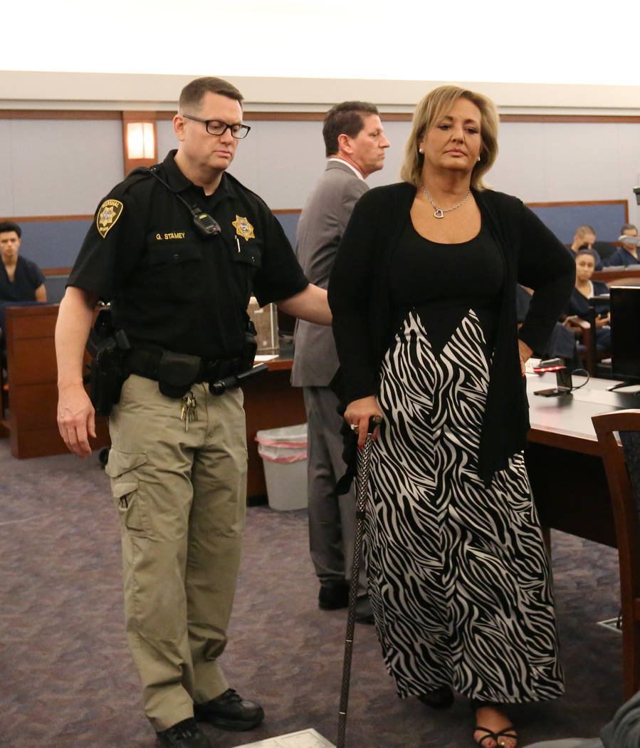 Vicki Greco, right, a suspended Las Vegas attorney who pleaded guilty to three felonies for her role in a scheme to defraud the court system, led out of the courtroom after her sentencing at the R ...