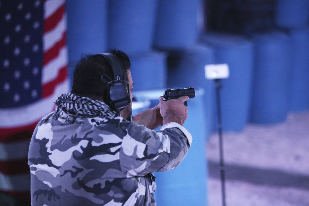 Nephi Oliva, owner of Las Vegas Gunfights, shoots a target to show how the FireFly indoor wireless gunshot sensor works at Las Vegas Gun Fights in Las Vegas, Monday, Sept. 24, 2018. The device is ...