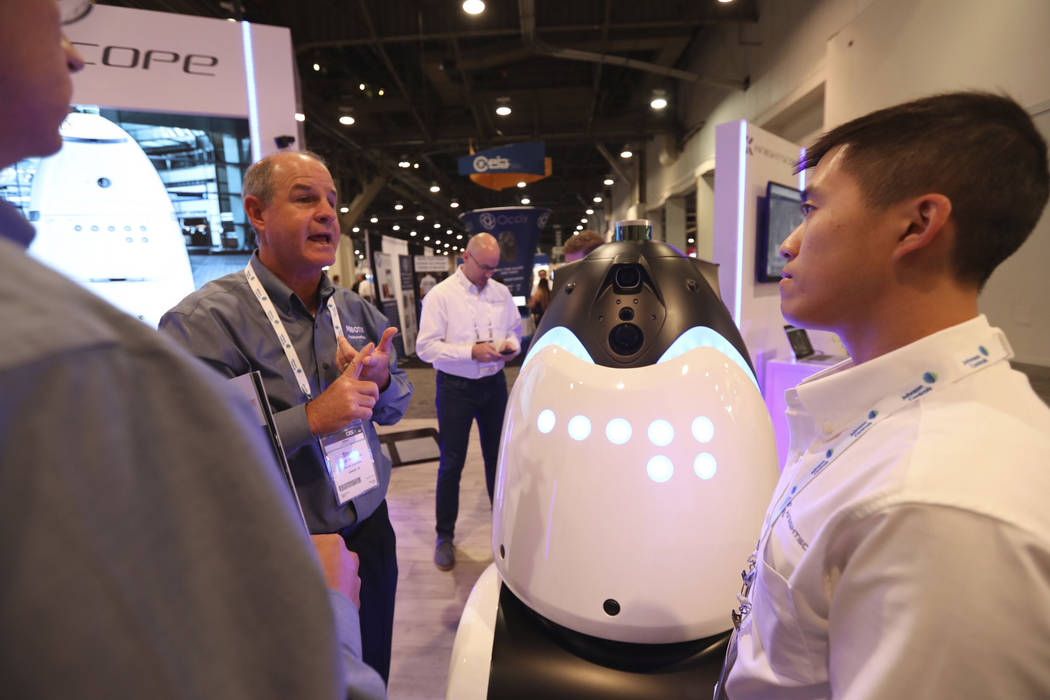Knightscope employees explaining their robots to GSX attendees at the Las Vegas Convention Center on Wednesday, September 26, 2018. (Todd Prince/Las Vegas Review-Journal)