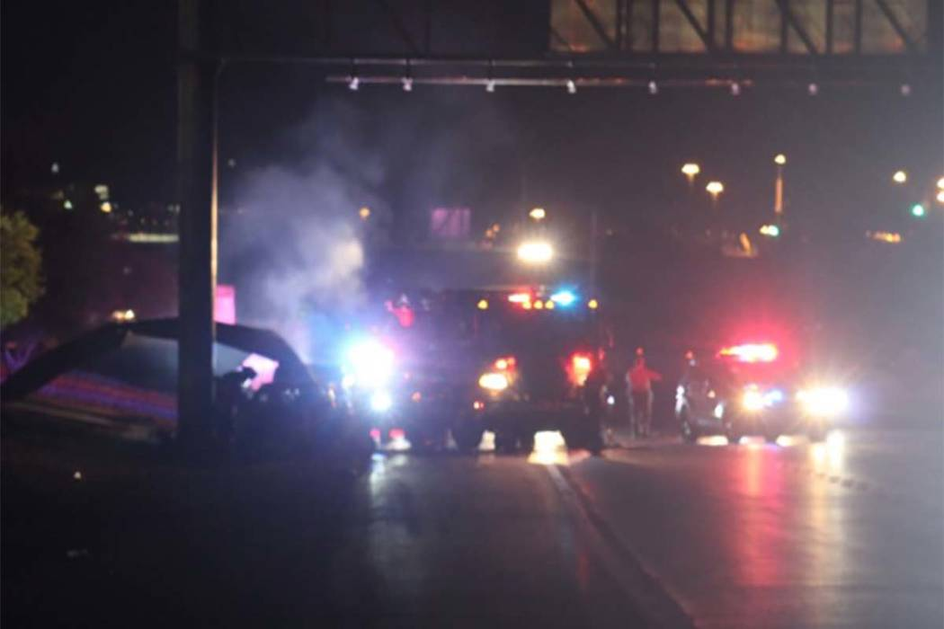 The two right lanes of westbound Summerlin Parkway were closed Thursday morning after a vehicle crashed into a pole and caught fire. (Max Michor/Las Vegas Review-Journal)