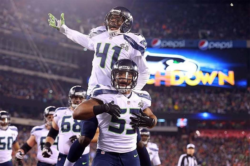 Seattle Seahawks outside linebacker Malcolm Smith (53) and cornerback Byron Maxwell (41) celebrate a touchdown during the first half against the Denver Broncos in Super Bowl XLVIII at MetLife Stad ...