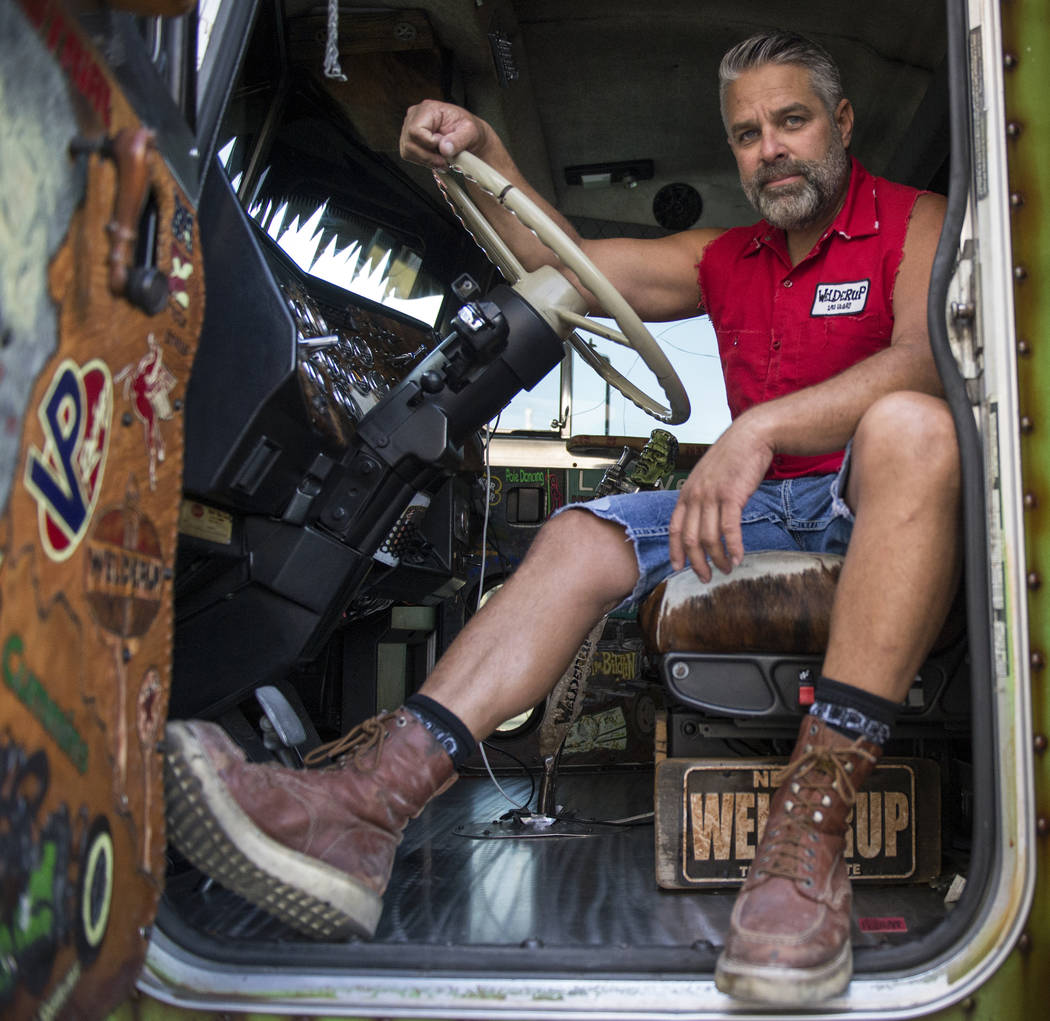 """Steve Darnell, the owner of Welder Up, the car fabrication series featured on Discovery's """"Vegas Rat Rods"""" poses for a portrait outside of a green monster truck he and his crew fixed up ..."""