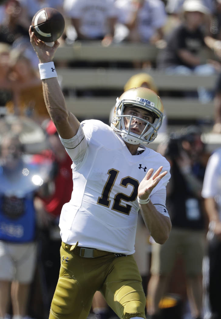 Notre Dame's Ian Book (12) looks to pass against Wake Forest in the first half of an NCAA college football game in Winston-Salem, N.C., Saturday, Sept. 22, 2018. (AP Photo/Chuck Burton)