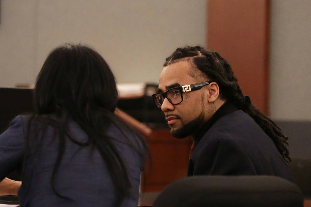 In this Tuesday, Sept. 25, 2018, file photo, Maurice Sims, acquitted of two counts of murder, while convicted of burglary in a 2013 home invasion and double homicide, talks with his attorney, Ivet ...
