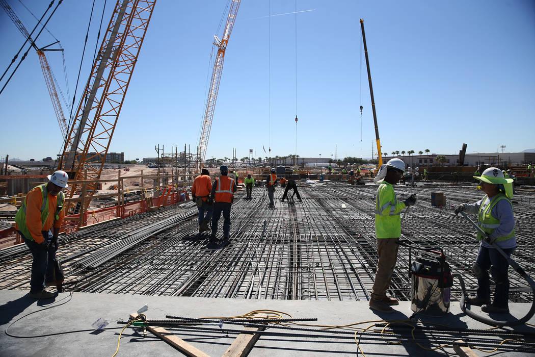 Construction workers at the site of the future Raiders stadium in Las Vegas, Thursday, Sept. 27, 2018. Erik Verduzco Las Vegas Review-Journal @Erik_Verduzco