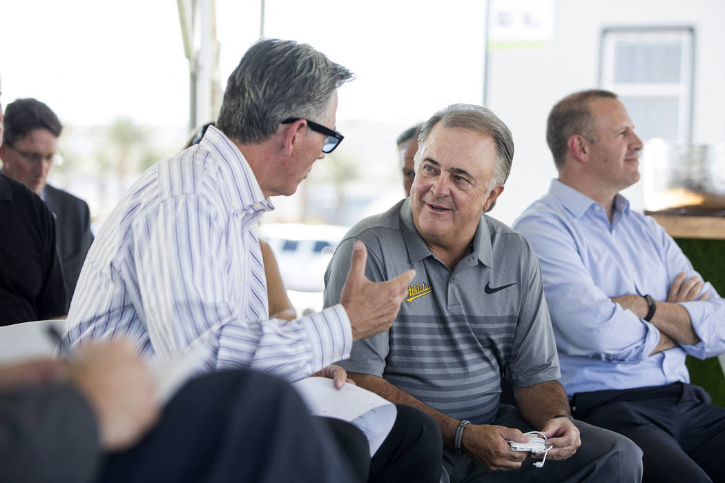Billy Beane, left, Oakland Athletics executive vice president of baseball operations, talks with Las Vegas 51s president Don Logan during a press conference to officially announce the 2-year playe ...