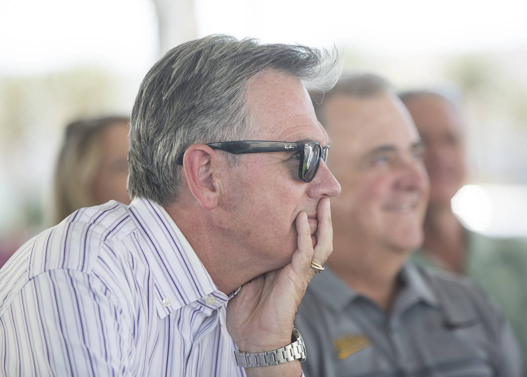 Billy Beane, Oakland Athletics executive vice president of baseball operations, listens to a speaker during a press conference to officially announce the 2-year player development contract between ...
