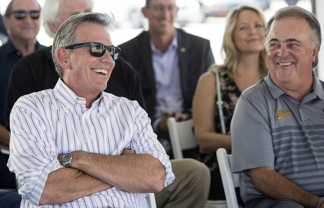 Billy Beane, Oakland Athletics executive vice president of baseball operations, shares a laugh with Las Vegas 51s president Don Logan during a press conference to officially announce the 2-year pl ...