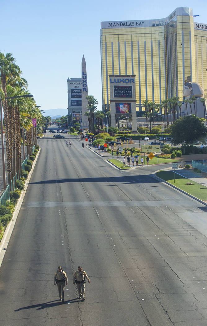 Metro, left/front, works to keep Las Vegas Boulevard south of Tropicana Avenue clear on Monday, October 2, 2017, in Las Vegas. A gunman in a Mandalay Bay hotel room shot into a crowd of thousands ...