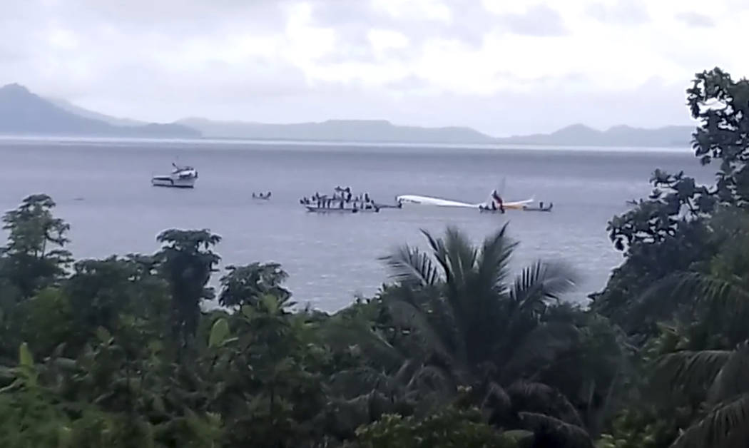 This image made from video photo provided by John Karl Louie Mallari shows an Air Niugini plane floating in Pacific lagoon near Chuuk Airport in Weno, Federated States of Micronesia, Friday, Sept. ...