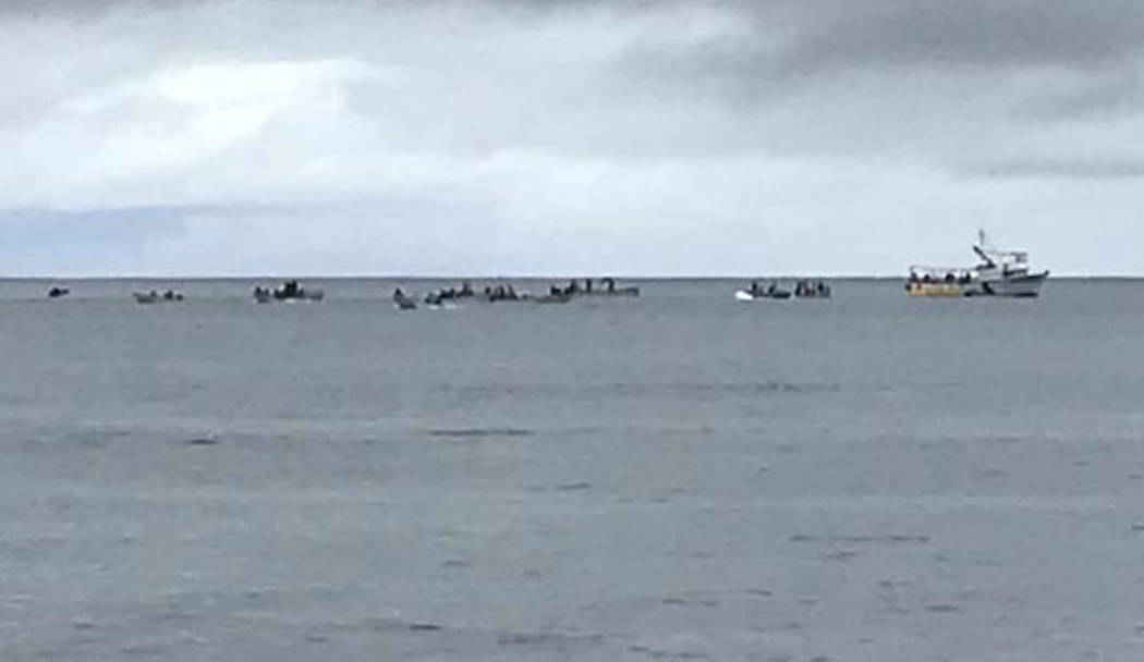 This image provided by Matthew Colson shows boats at the site after the fuselage of an Air Niugini plane got underwater in Pacific lagoon near Chuuk Airport at Chuuk Island, Federated States of Mi ...