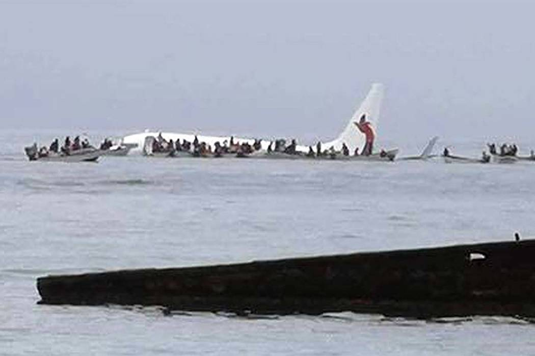 This photo provided by Blue Flag Construction shows an Air Niugini plane floating in Pacific lagoon after its crash-landing in Pacific lagoon near Chuuk Airport in Weno, Federated States of Micron ...