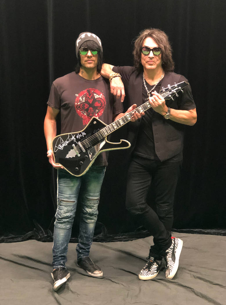 Criss Angel and Paul Stanley are shown with a guitar Stanley has donated to Angel for display at his new theater at Planet Hollywood. (Criss Angel)