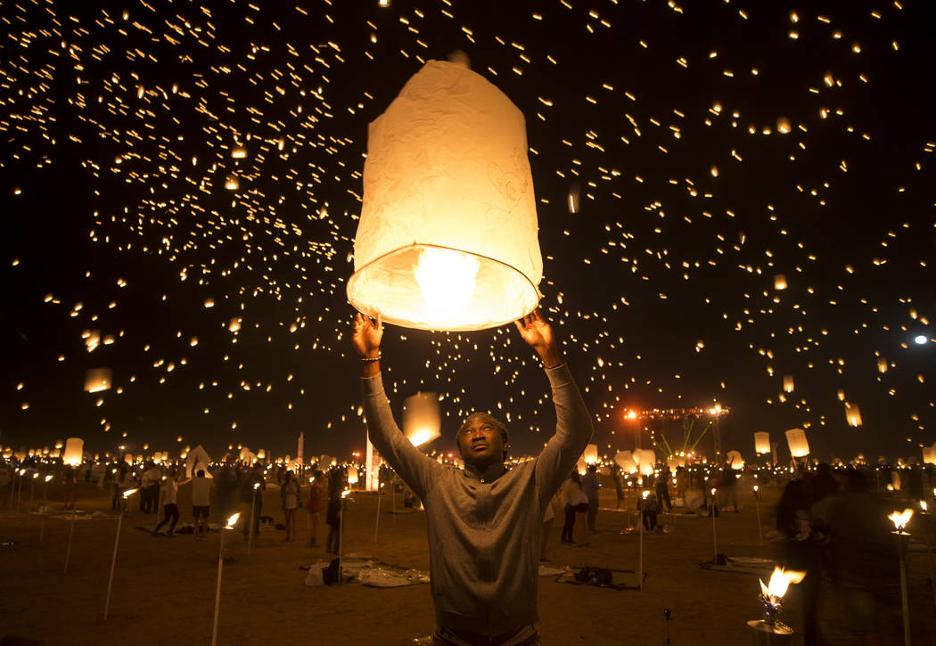 Learie Hercules of the Republic of Trinidad and Tobago releases a lantern during the RiSE Lantern Festival held at the Moapa River Indian Reservation on Friday, Oct. 6, 2017. Richard Brian Las Veg ...
